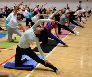 KUNMING, June 21, 2018 - Yoga goers attend a workshop held by the India-China Yoga college of Yunnan Minzu University in Kunming, southwest China's Yunnan Province, June 21, 2018. The UN General ...