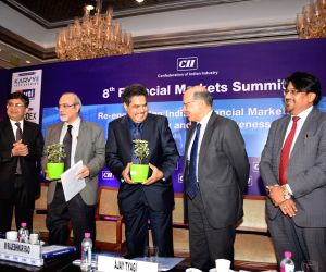 (L-R) Bombay Stock Exchange MD and CEO Ashishkumar Chauhan, Reserve Bank of India Executive Director Rajeshwar Rao, Securities and Exchange Board of India (SEBI) Chairman Ajay Tyagi, ...