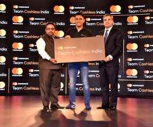 (L-R) Confederation of All India Traders National Secretary General Praveen Khandelwal, Indian cricketer and Mastercard Brand Ambassador M.S. Dhoni and Mastercard Co-President (Asia Pacific) Ari ...