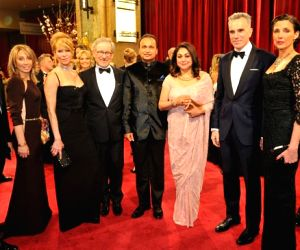 (L to R) Gary Jones, Stacey Snider, Kate Capshaw, Steven Spielberg, Anil Ambani, Tina Ambani, Daniel Day Lewis and Rebecca Miller at the Oscars red carpet on Feb. 25, 2013.