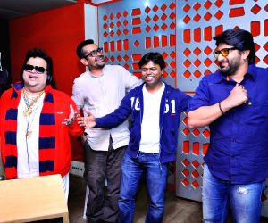 Bappi Lahiri, Amrita Rao and Arshad Warsi at a song recording for Jolly LLB
