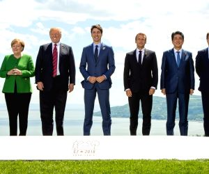LA MALBAIE, June 8, 2018 - Participants of the Group of Seven (G7) summit European Union Council President Donald Tusk, British Prime Minister Theresa May, German Chancellor Angela Merkel, U.S. ...