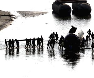 Pontoon bridge being constructed ahead of 'Magh Mela' festival