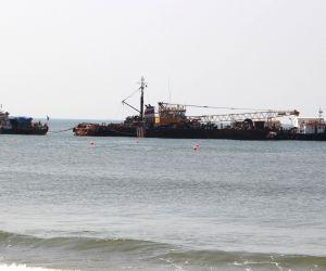 Sinquerim beach: Labourers remove debris of the ship 'River Princess'