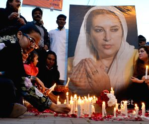 LAHORE, Dec. 27, 2015 (Xinhua) -- Activists of the Pakistan Peoples Party light candles on the death anniversary of former prime minister Benazir Bhutto in eastern Pakistan's Lahore on Dec. 27, 2015. Bhutto was assassinated on Dec. 27, 2007 following
