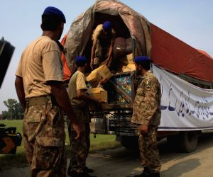 Trucks carrying relief supplies for internally displaced Pakistani civilians