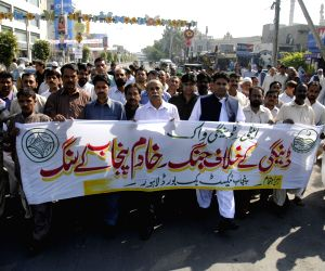 People march during the Anti-Dengue walk in eastern Pakistan's Lahore