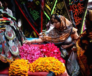 Pakistani Shiite Muslims buy goods at a special decoration shop during the Muslim month of Muharram