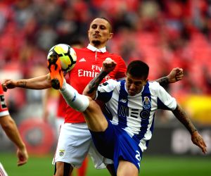 LISBON, April 16, 2018 - Fejsa (L) of Benfica vies with Otavio of Porto during Portuguese League soccer match between SL Benfica and FC Porto in Lisbon, Portugal, April 15, 2018. Porto won 1-0.