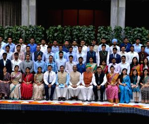 Lok Sabha Speaker Om Birla and Union Minister Arjun Ram Meghwal pose for a group photo with 2017 batch IAS Officers at Parliament Annexe in New Delhi, on July 17, 2019.