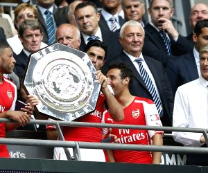 Celebrate after the Community Shield match between Arsenal and Manchester
