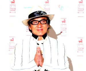 Jackie Chan attends a photocall