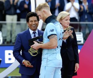 London: England's Ben Stokes with cricket legend Sachin Tendulkar during the presentation ceremony after England won 2019 World Cup at Lord's in London on July 15, 2019. (Photo: Surjeet Yadav/IANS)