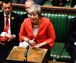 LONDON, Feb. 28, 2019 (Xinhua) -- British Prime Minister Theresa May attends the Prime Minister's Questions in the House of Commons in London, Britain, on Feb. 27, 2019. Theresa May promised on Tuesday that the members of parliament (MPs) would be gi