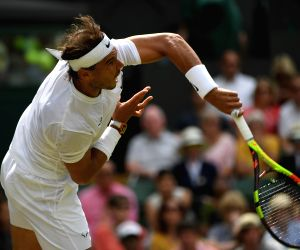 LONDON, July 8, 2019 (Xinhua) -- Rafael Nadal of Spain competes during the men's singles fourth round match between Rafael Nadal of Spain and Joao Sousa of Portugal at the 2019 Wimbledon Tennis Championships in London, Britain, on July 8, 2019. (Xinh
