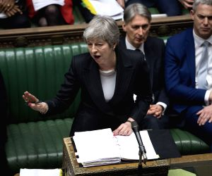 LONDON, March 20, 2019 (Xinhua) -- British Prime Minister Theresa May (Front) speaks during the Prime Minister's Question Time in the House of Commons in London, Britain, on March 20, 2019. Theresa May confirmed Wednesday she has written to the Europ