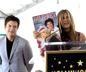 LOS ANGELES, July 27, 2017 - Actress Jennifer Aniston (R) shows a picture of actor Jason Bateman during a star honoring ceremony on the Hollywood Walk of Fame in Los Angeles, the United States, July ...