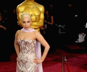 Lady Gaga arrives at the red carpet for the 2014 Oscars at the Dolby Theatre in Hollywood, California, the United States, March 2, 2014.