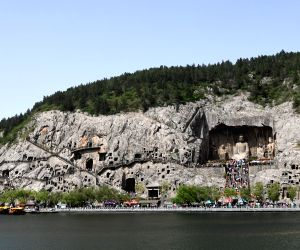 CHINA HENAN LUOYANG LONGMEN GROTTOES TOURISM