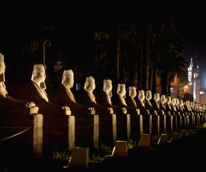Luxor (Egypt): Statues in the Luxor Temple are seen illuminated at night