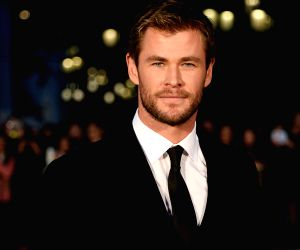 Actor Chris Hemsworth arrives on the red carpet for the 15th Huading Awards, the release ceremony of the Global Entertainment Celebrities Satisfaction Survey, in ...