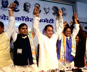 Madhya Pradesh Chief Minister and Congress leader Kamal Nath with former BSP leaders Pradeep Ahirwar (second from Left), Deoraj Singh (first from Right) and other leaders of BSP during a ...