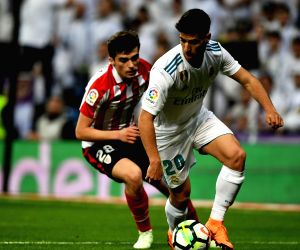MADRID, April 19, 2018 - Real Madrid's Asensio (R) and Ath. Bilbao's Cordoba compete during a Spanish league match between Real Madrid and Athletic Club Bilbao in Madrid, Spain, on April 18, 2018. ...