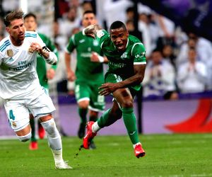MADRID, Jan. 25, 2018 - Leganes' Claudio Beauvue (1st R) vies with Real Madrid's Sergio Ramos (1st L) during the Spanish King's Cup quarterfinal match between Real Madrid and Leganes in Madrid, ...