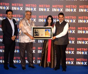 Devendra Fadnavis, Amruta Fadnavis and Boney Kapoor at the inauguration of a cinema theatre