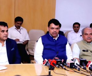 Maharashtra Chief Minister Devendra Fadnavis interacts with the media after the High Powered Committee for Transformation of Indian Agriculture at NITI Aayog, in New Delhi on July 18, ...