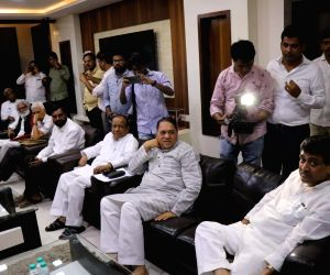 Maharashtra Congress chief Ashok Chavan along with NCP leaders during a joint meeting in Mumbai on May 28, 2019.