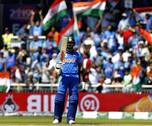 Kohli, Dhoni's half-centuries help India post 268/7