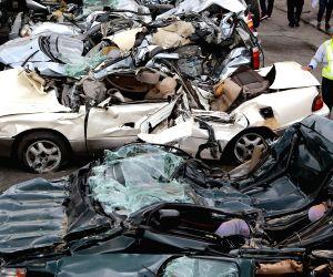 THE PHILIPPINES-MANILA-SMUGGLED LUXURY CARS-CRUSH