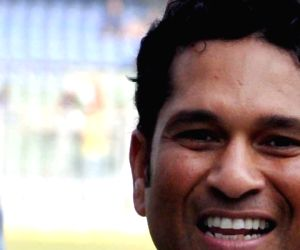 Master blaster Sachin Tendulkar with a stamp booklet released on his name by Department of Posts ahead of his 200th and the last test match at Wankhede Stadium in Mumbai on Nov.14, 2013. (Photo: ...