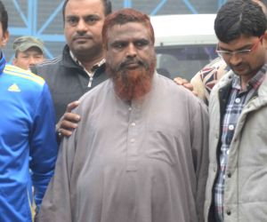 Maulana Anzar Shah, a suspected member of the Al Qaeda terrorist outfit being taken to be produced in a Delhi court, on Jan 8, 2016.