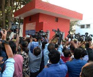 Media personnel gather outside Dasna jail in Ghaziabad as dentist couple Rajesh and Nupur Talwar walk out of the jail after Allahabad High Court acquitted them of the murder of their ...