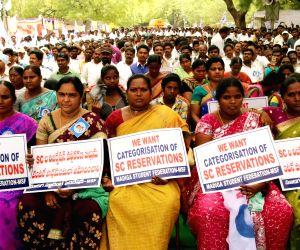 Madiga demand schedule caste status
