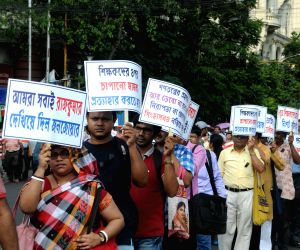 Members of West Bengal's Para Teachers Open Forum participate in a protest rally to press for a CBI inquiry the mysterious death of Rajkumar Ray, presiding officer at a polling booth in ...