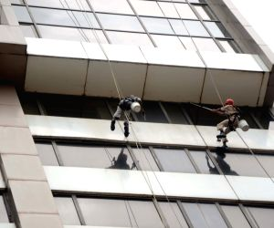 Men busy cleaning building