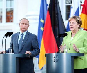 MESEBERG (GERMANY), Aug. 18, 2018 German Chancellor Angela Merkel (R) and visiting Russian President Vladimir Putin attend a joint press conference at the Schloss Meseberg, north of ...