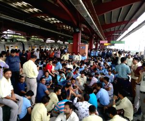 Metro railway employees staging a sit-in demonstration at Yamuna Bank Metro station in New Delhi on June 29, 2018. A day before an indefinite strike proposed by a section of the Delhi ...