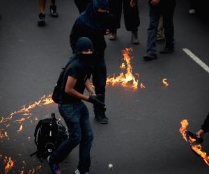 Mexico City (Mexico): People clash with riot police in Mexico City