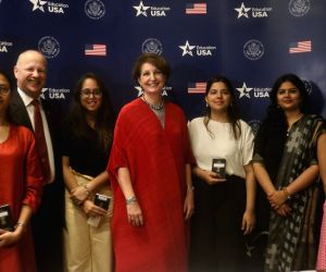 Minister Counsellor at the American Embassy in India Joseph Pomper and Charge d'Affaires of the US Embassy in New Delhi, MaryKay Carlson with student visa applicants during a programme ...