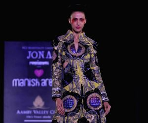 Model walk on the ramp for Manish Arora for Amby Valley Indian Bridal Week at Sahara Star.