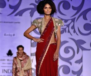 Model walk on the ramp for Rocky S at Amby Valley Indian Bridal Week.