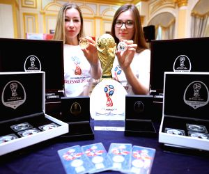 Models display official commemorative coins and medals for FIFA World Cup Russia 2018 during their launch ceremony at the Russian embassy in Seoul on May 25, 2018. Some of the medals were ...