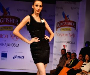 Models walk at SCMM Fashion Night at Hilton Towers in Mumbai.