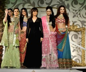 Model Walks for designers Arjun and Anjalee Kapoor at Aamby Valley India Bridal Week day 2.