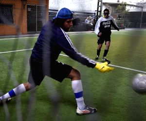 Blind people vie during a training session