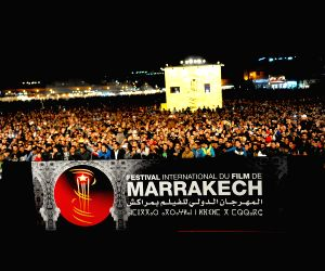 Present the film 'Happy New Year' at the 14th Marrakech International Film Festival